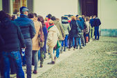 Retro look People queueing — Stock Photo