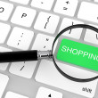 Magnifier with Shopping key — Stock Photo #11414015