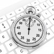 White computer keyboard with stopwatch — Stock Photo #12556027