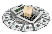 Dollars with House and calculator — Stock Photo