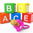 Alphabetical blocks and pacifier — Stock Photo