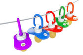Row of babies pacifiers with rope — Stock Photo