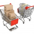 Shopping carts with boxes and money — Stock Photo