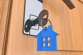 Home key with house keychain symbol — Stock Photo