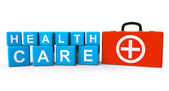 Cubes with Health Care sign and First Aid Case — Stock Photo