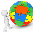 Stock Photo: 3d person with Sphere from Color Puzzles