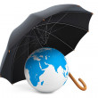 Protection of an environment concept. Umbrella covers the planet — Stock Photo