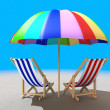 Two beach chairs under sunshade — Stock Photo