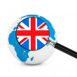 Magnified flag of England with Earth Globe — Stock Photo
