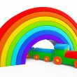 图库照片: Toy multicolor train under rainbow bridge