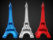 Three Eiffel towers glow in French flag colors — Stock Photo