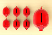 Growing investment concept. Red Piggy Banks in row — Stock Photo