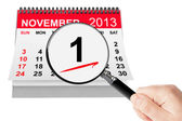 All Saints Day Concept. 1 November 2013 calendar with magnifier — Stock Photo