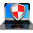 Antivirus concept. Laptop computer protected by shield — Stock Photo
