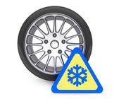 Winter Car Wheel Tire with snowflake sign — Stock Photo