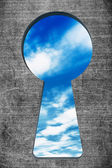 Blue sky seen through the keyhole — Stock Photo