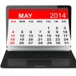 Постер, плакат: May calendar over laptop screen