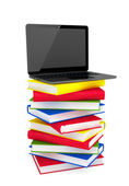 E-learning concept. Laptop on top of stack of colorful books — Stock Photo