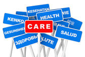 Health Care multilanguages banner signs — Stock Photo