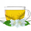 Glass cup of green tea with jasmine flowers isolated on white — Stock Photo #11027031