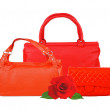 Стоковое фото: Red women bags and rose flower isolated on white background