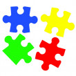 Stock Photo: Colorful puzzles closeup isolated on white