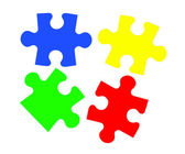 Colorful puzzles closeup isolated on white — Stock Photo