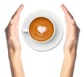 Latte coffee with heart symbol and woman hands isolated on white — Stock Photo