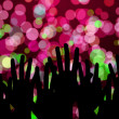 Festive lights and people hands on night music concert — Stock Photo