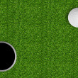 Stock Photo: Golf ball and hole on green grass of golf course