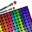 Professional multicolor eyeshadow palette for makeup and brushes — Stock Photo #41813729