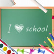 Small school desk with various school supplies close-up isolated — Stockfoto