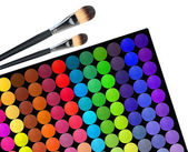 Professional multicolor eyeshadow palette for makeup and brushes — Stock Photo