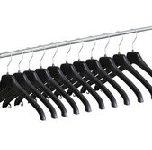 Black clothes hangers on white background — Stock Photo