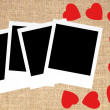 Red hearts and photo card on sack canvas burlap background textu — Stock Photo