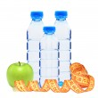 Blue bottles with water, measure tape and green apple isolated o — Stock Photo #44077497