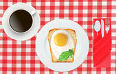 Scrambled eggs with bread on plate on color napkin and coffee cu — Stock Photo