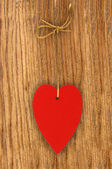 Love heart hanging on wooden texture background, valentines day  — Stock Photo