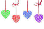 Painted hearts hanging on the white background — Stock Photo
