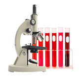 Laboratory metal microscope and test tubes with liquid isolated  — Stock Photo