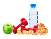 Red dumbbells fitness, green apple, bottle of water and measure — Stock Photo