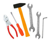 Hammer, screwdriver and wrenches isolated on white — Stock Photo