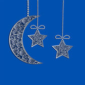 Hanging decoration filigree lace moon and stars — Stock Photo