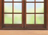 Wooden table and window and nature background — Stock Photo