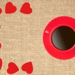 Border frame of red hearts and coffee cup on sack canvas burlap — Stock Photo