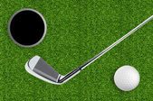 Golf ball and hole on the green grass of the golf course — Stock Photo