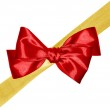 Golden ribbon and red bow isolated on white background — Stock Photo #7945906
