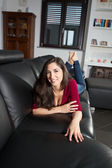 Model smiling on sofà — Stock Photo