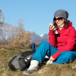 Female hiker using cell phone ontop of mountain — Stock Photo #37369543