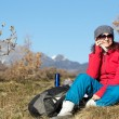 Female hiker using cell phone ontop of mountain — Stock Photo #37371505